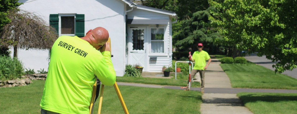Two professionals in a land surveying career.
